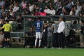 Kitchee substitute Brian Fok is told to return to the bench after being denied his debut against Manchester City. Photo: Zinc Yeung/Offside.hk