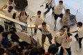 Men in white T-shirts on the rampage at Yuen Long MTR station on June 21. Photo: Handout
