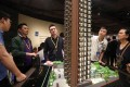 Potential buyers view a model of New World Development's Atrium House in Tsuen Wan on June 22. Some have suggested that the shrinking sizes and high cost of homes in Hong Kong lies at the root of young people's discontent. Photo: Xiaomei Chen