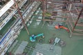 Construction equipment is submerged by flooding on Thursday at the building site of the West Kowloon Cultural District. Photo: Winson Wong