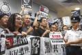 Protesters shout slogans at Yuen Long police station on July 22, accusing officers of colluding with gangsters, after commuters were attacked with sticks and metal rods at Yuen Long MTR station late on July 21. Photo: Felix Wong