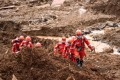 A landslide in Shuicheng county, Guizhou province, buried 22 houses on Tuesday. Photo: Xinhua