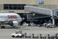 A Swissport baggage cart at Zurich airport. The Swiss luggage handler was bought by Chinese HNA Group for 2.73 billion Swiss frances (US2.81 billion US dollars. Photo: EPA