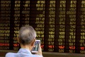 A man monitors stock prices at a brokerage in Beijing on June 25, 2019. Photo: Associated Press