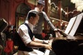 Donnie Yen playing the piano in Legend of the Fist: The Return of Chen Zhen (2010), directed by Andrew Lau (back).