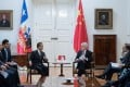 Chilean President Sebastian Pinera speaks with Chinese Foreign Minister Wang Yi (left) at the government house in Santiago, Chile, on Saturday. Photo: Reuters