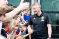 Manchester United manager Ole Gunnar Solskjaer greets fans after a training session in Oslo, Norway. Photo: EPA