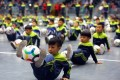 Children playing with their footballs at a gymnasium in Tianjin on December 16, 2017. Photo: Xinhua