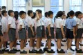 Students photographed on the first day of school at the King's College Old Boys' Association Primary School No 2 in Sheung Wan last year. Photo: Sam Tsang