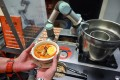 Sophie the robotic chef can serve up a piping hot bowl of laksa in under a minute. Photo: AFP