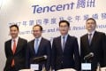 Tencent Holdings, China's largest games publisher, is now the biggest pay master among Hong Kong-listed companies. From left: Chief Strategy Officer James Mitchell, President Martin Lau Chi-ping, Chairman and CEO Pony Ma Huateng and CFO John Lo Shek-hon during an event on 21 March 2018. Photo: SCMP/Winson Wong