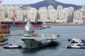 The carrier leaves the port of Dalian for a sea trial in December. Photo: Reuters
