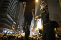 Young protesters signal to one another during clashes with riot police on the night of July 28. Photo: James Wendlinger