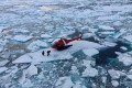 A helicopter from the Swedish icebreaker Oden lands on an ice floe to pick up crew members retrieving a data recorder on Arctic marine life movements, in the Canadian Arctic on July 25. Sweden is one of the eight members of the Arctic Council, whose mission is cooperation on environmental protection, sustainable development, and avoidance of military or strategic matters. Photo: Inner Space Centre via Reuters