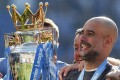 Manchester City coach Pep Guardiola celebrates with the 2018-19 English Premier League trophy but could he win at Fantasy Football? Photo: AP