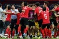 South Korea's national soccer team celebrate their opening goal against Germany at the 2018 World Cup. Photo: EPA