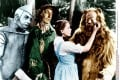 Classic American Films: The Wizard of Oz. Dorothy comforts the Cowardly Lion while the Tin Man and The Scarecrow look on.