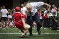 Boris Johnson knocks over a Japanese child during an exhibition rugby tournament in Tokyo. Japan has not been bowled over by Britain's decision to exit the European Union – an idea championed by the new British prime minister. Photo: AP