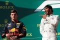 Mercedes' Lewis Hamilton celebrates winning the Hungarian Grand Prix as Red Bull's Max Verstappen looks on, on Sunday. Photo: Reuters
