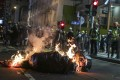 Protesters set fires in Mong Kok on Saturday. Photo: Edmond So