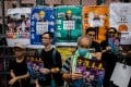 Protesters at a rally against the government in Mong Kok on Saturday. With workers from various sectors expected to join the strike, Hong Kong could see large-scale disruptions on Monday. Photo: AFP