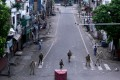 Security personnel stand guard on a deserted street in Jammu on August 6. India has revoked the special status of the Muslim-majority state of Jammu and Kashmir. Photo: AFP