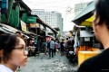 Stalls that sell everything from bread to children's toys pepper the narrow streets of San Roque in Metro Manila in the Philippines. The neighbourhood is under threat of demolition to make way for a commercial development. Photo: Maro Enriquez