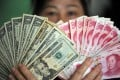 In the long run and given China's economic heft, the yuan could emerge as a rival to the greenback. Photo: Xinhua