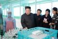 North Korean leader Kim Jong-un and his wife, Ri Sol-ju, visit a cosmetics factory in Pyongyang. Photo: Reuters