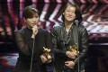 Taiwanese documentary director Fu Yue (left), with producer Hong Ting Yi, delivers her Golden Horse Awards acceptance speech last year, in which she voiced support for an independent Taiwan. The speech is the ostensible reason for China's decision to boycott the awards. Hong Kong film producers will join the boycott. Photo: AP