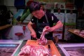 China's consumer inflation remained high in July, due in large part due to the cost of pork, with the African swine fever crisis ravaging the pig population in the world's biggest consumer of pork. Photo: AFP