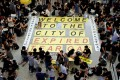 Demonstrators stage sit-in at the arrival hall of Hong Kong airport. Photo: Reuters