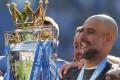 Manchester City coach Pep Guardiola lifts the English Premier League trophy. Photo: AP