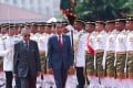 Malaysia's Prime Minister Mahathir Mohamad and Indonesia's President Joko Widodo inspect the honour guards in Putrajaya. Photo: AFP