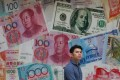 Analysts have warned that a potential currency war could result in a global financial crisis and recession. Photo: Felix Wong
