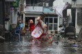 After Typhoon Lekima hit Linhai in Zhejiang province, residents began to rescue what belongings they could. Photo: Reuters
