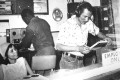 """VP Records' Patricia Chin and Vincent """"Randy"""" Chin (right) in Randy's Records in Jamaica (1958)."""
