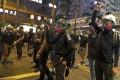 Protesters with protection gear face riot police in Hong Kong. Photo: AP