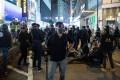 Men in black believed to be officers in Causeway Bay. Photo: Kyle Lam/Bloomberg
