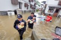 Policemen helping people stranded by floods in Zhoushan City, a part of China's Zhejiang Province, on Saturday. Typhoon Lekima, the ninth of the year, made landfall in Wenling City. Photo: Xinhua