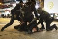 A protester is restrained by three police officers during clashes in Hong Kong. Photo: James Wendlinger