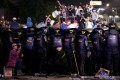Riot police officers guard during a riot near the Election Supervisory Agency (Bawaslu) headquarters in Jakarta. Photo: Reuters