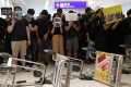 Anti-government protesters at Hong Kong International Airport paralysed one of the world's busiest aviation hubs for a second consecutive day on Tuesday. Photo: Sam Tsang