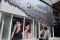 People walk past a Swarovski store in Beijing on Monday. Photo: EPA-EFE