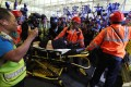 Global Times reporter Fu Guohao is taken to an ambulance by paramedics after being tied up by anti-government protesters at Hong Kong International Airport on Tuesday night. Photo: Sam Tsang