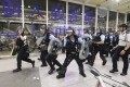 Riot police at the airport. Photo: Felix Wong