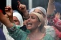 A woman shouts slogans during a protest in Srinagar on Wednesday. Photo: Reuters