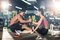 Young Chinese couple exercising at gym - smart materials and wearable tech are popular in the sports industry. Photo: Alamy