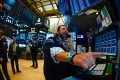 """Traders at work after the opening bell at the New York Stock Exchange on August 15, when Wall Street stocks opened higher following mixed US economic data, bouncing modestly after the Dow suffered its worst session of the year. But brief """"relief rallies"""" could be more signs that the markets are flying blind towards a crash landing. Photo: AFP"""