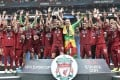 Liverpool players celebrate with the trophy after winning the Uefa Super Cup against Chelsea at Besiktas Park Stadium in Istanbul. Photo: AFP